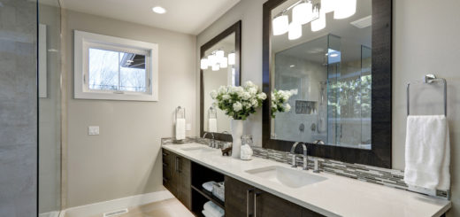Spacious bathroom in gray tones with long double sink vanity and heated floors. Northwest, USA